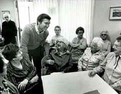 Cohen talking with senior citizens