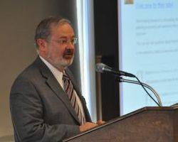 Mike Hastings introduces the keynote speaker.