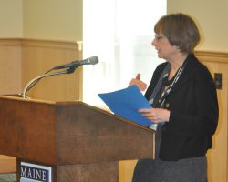 Joyce Rumery welcomes the audience to the 2010 Forum
