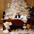 Office worker with mound of paperwork