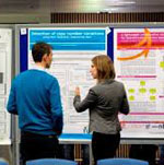 two people viewing poster presentations