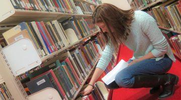 work-study student shelving books