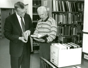 Raymond Vigue in Fogler Library's Special Collections Department, 1998