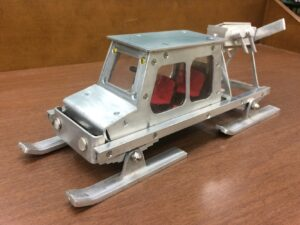 A scale model of a 1947 air propelled sled used for transportation in Maine.
